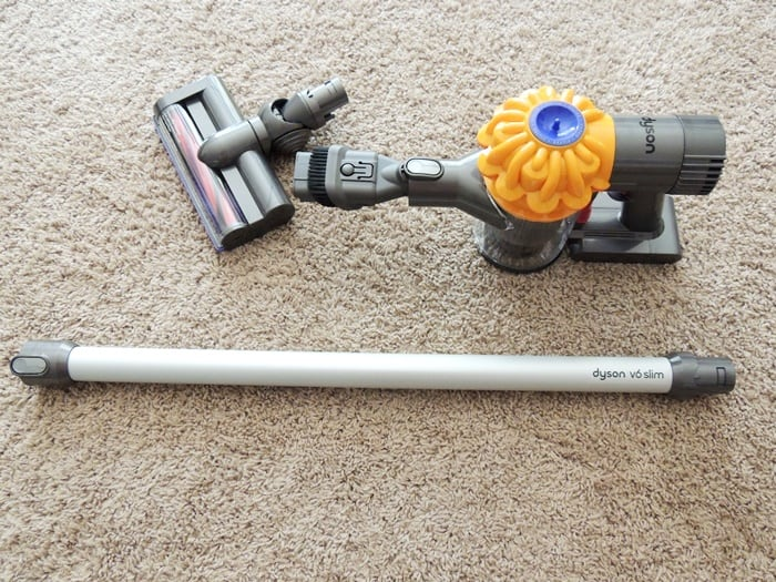 Attach a dusting brush to one end of the vacuum hose