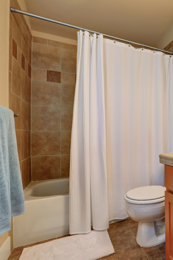 Hang Shower Curtains with Rods from the Shower Ceiling