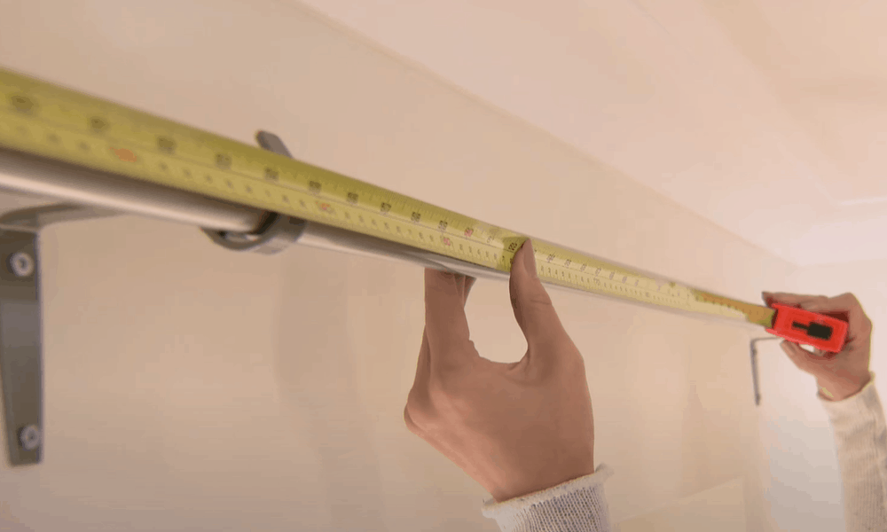 Measure the width of your curtain pole or track