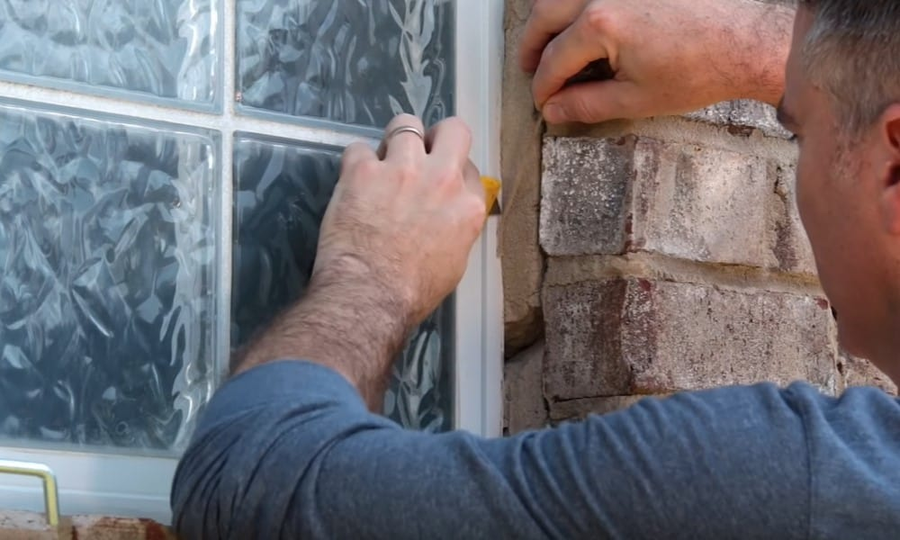 Remove old caulk from the windowpane