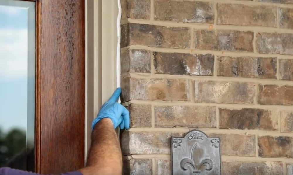Use a rag to remove excess caulk