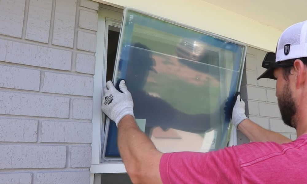 Fix in the New Energy-Efficient Glass Pane ad Apply New Caulking to Hold