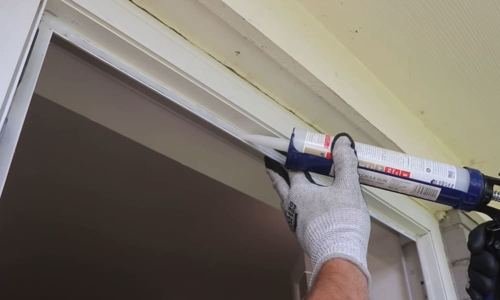 Lay-In New Caulking on the Bare Window Frame