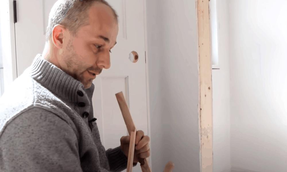 Add blocks of wood to the door jambs