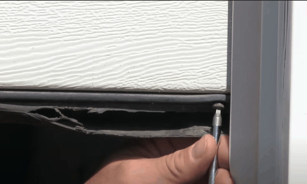 Check for screws holding the existing door seal in place