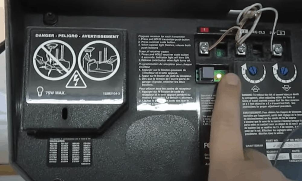 """Press """"SRT"""" button on garage door opener"""