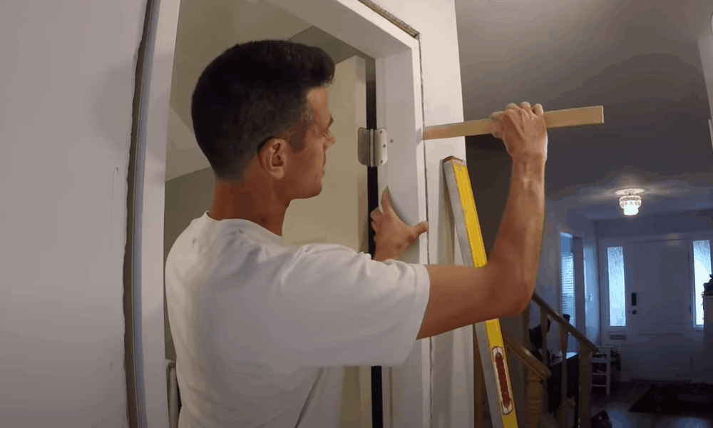 Secure the frame with shims
