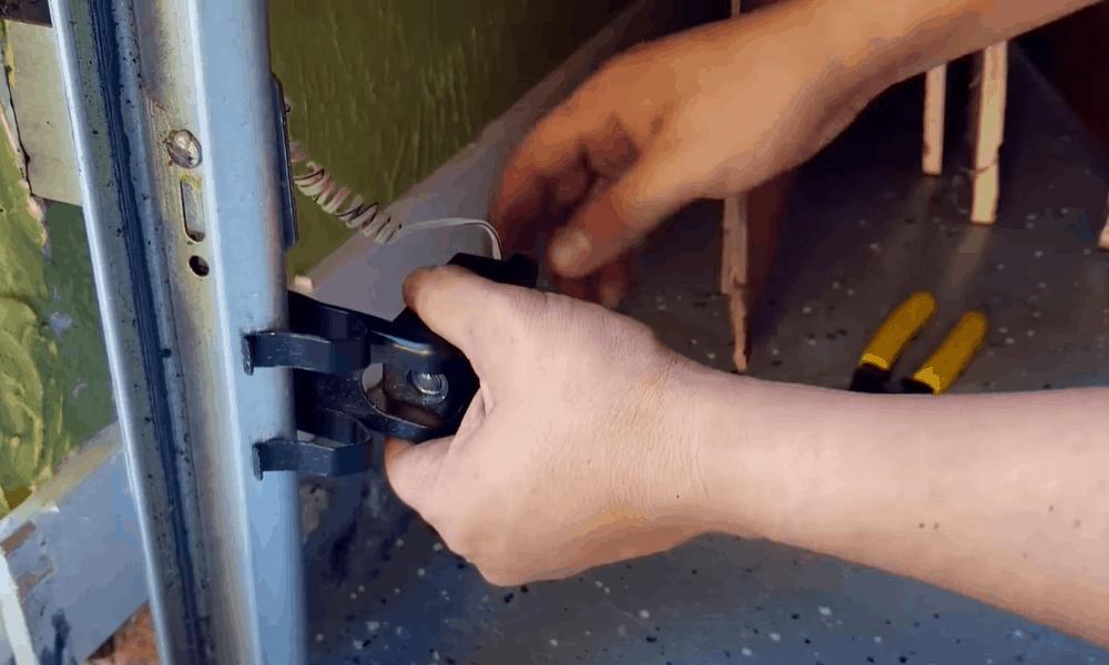 Slide the garage door sensors downward