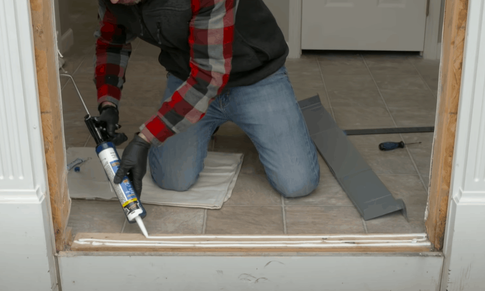 Apply caulk and set the pre-hung door