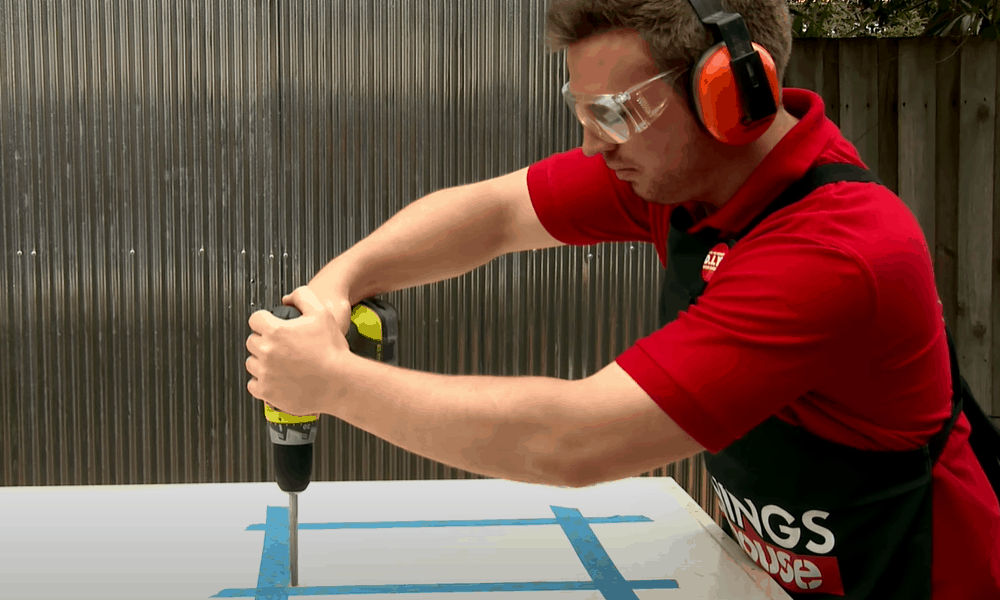 Drill a hole at each corner of the template