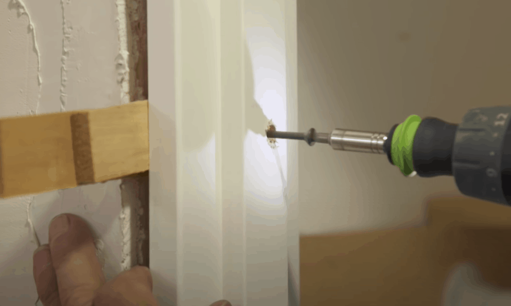 Hang the door and do additional shimming
