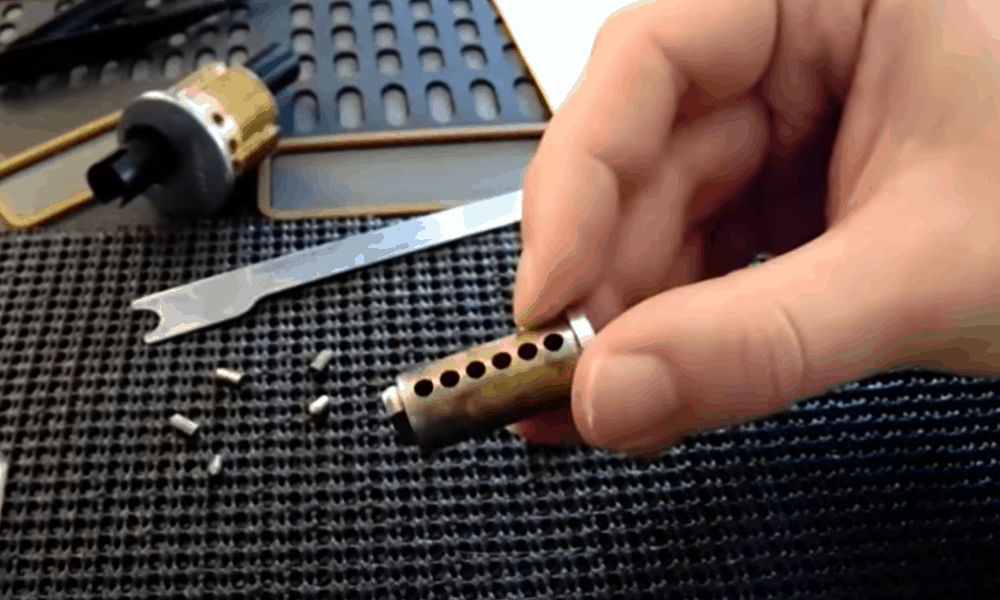 Remove the lower lock pins