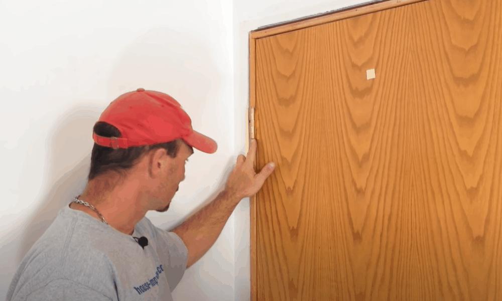 Unfasten screws from spring-loaded hinges