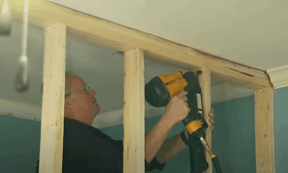 Position and secure the wall frame