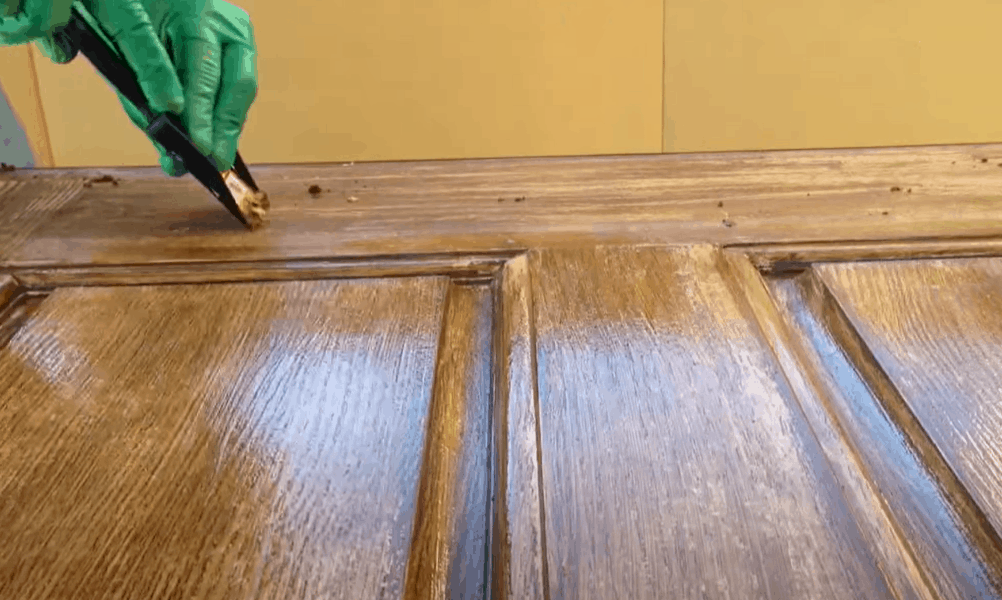 Remove the existing finish from the door (optional)