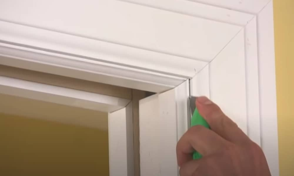 Scratch Off the Caulk on the Door Stop