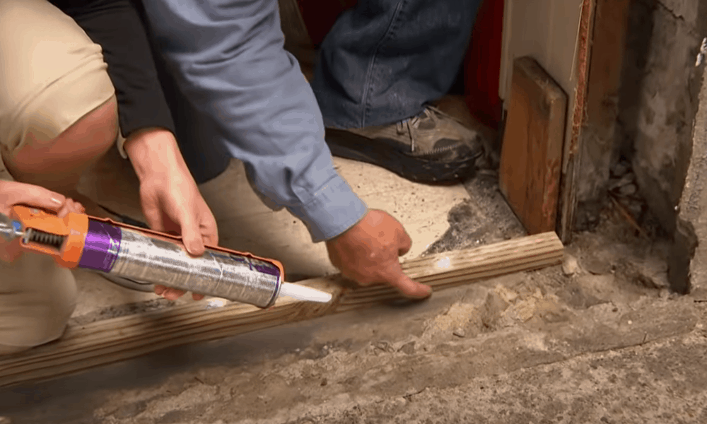 Weatherproof the door opening using a drip cap and sill pan