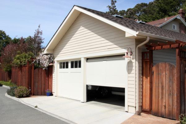 7 Reasons Why Garage Door Is Opening By Itself (Fix Tips)